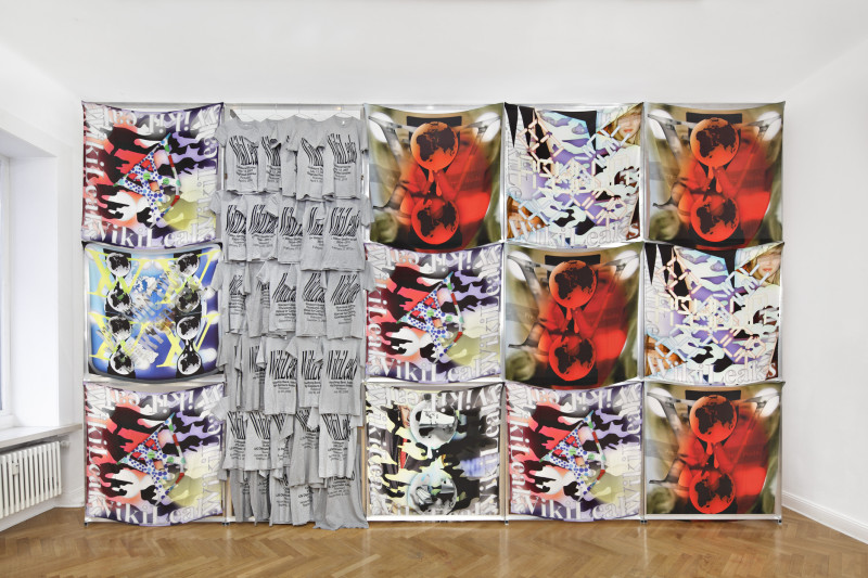 Transparent Camouflage, 2011-2013 WikiLeaks scarves and t-shirts Digital print on crêpe de chine, silkscreen on cotton, aluminum frames 600 x 360 cm